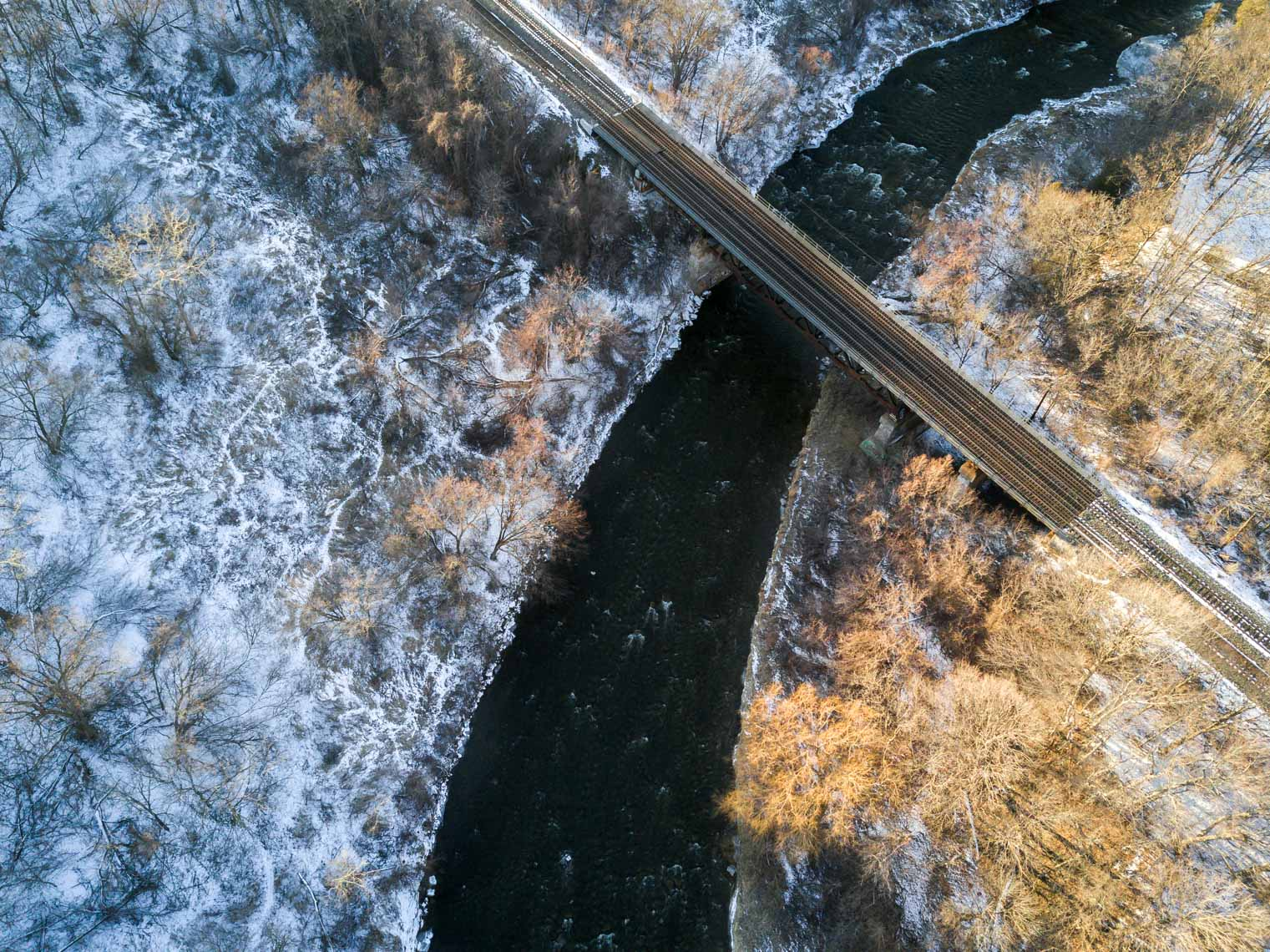 Aerial view of Streetsville Mermorial Park bridge in winter