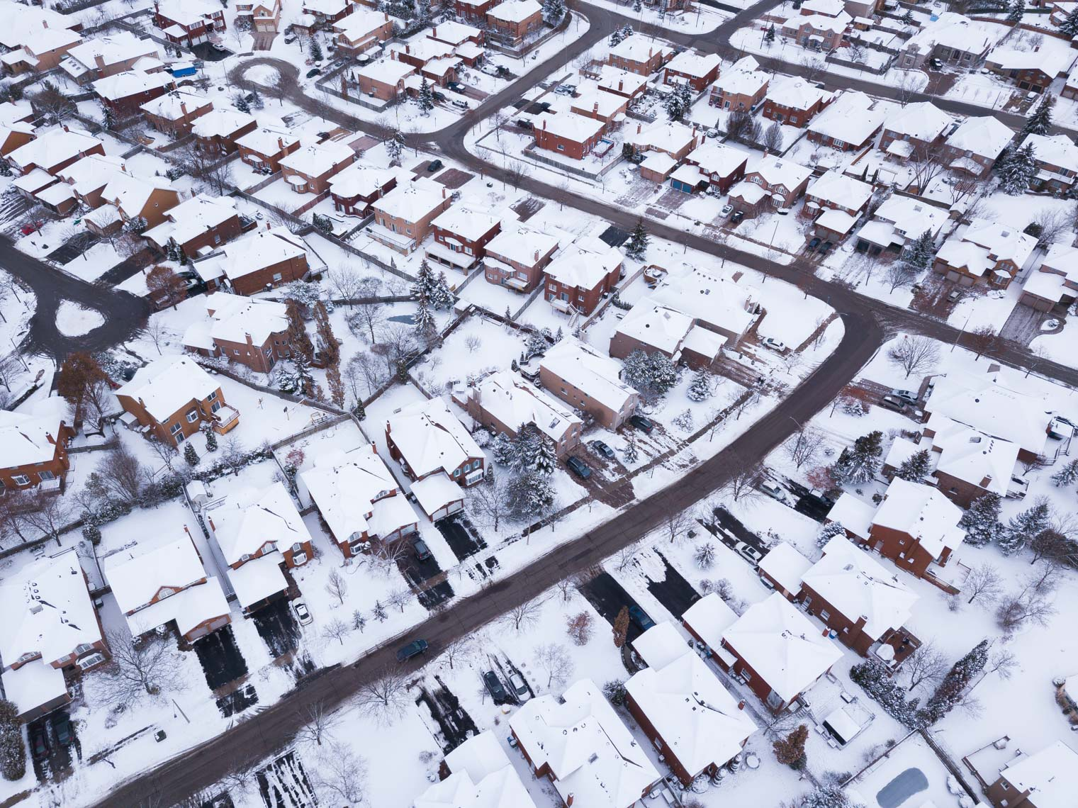 Aerial view of snowy Mississauga subdivisions in winter