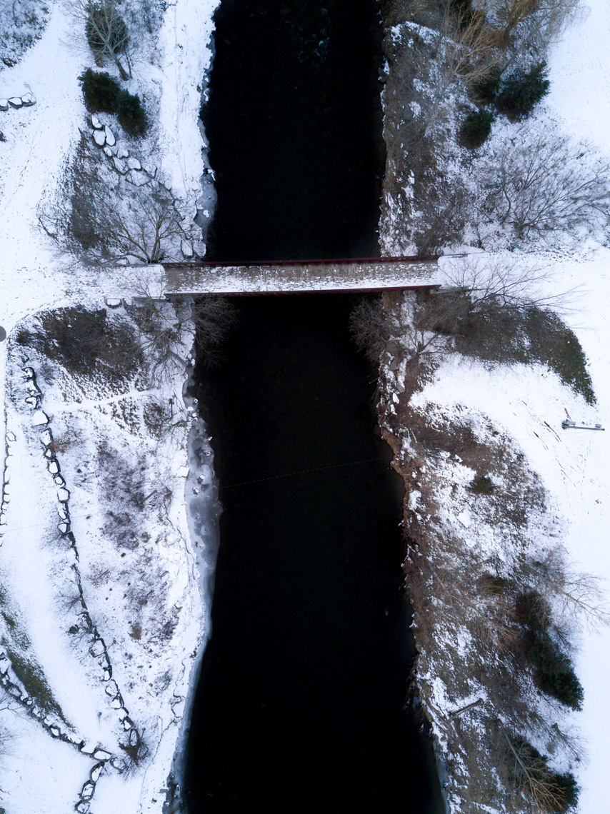 Aerial view of Go Bridge and Credit River in Streetsville in winter