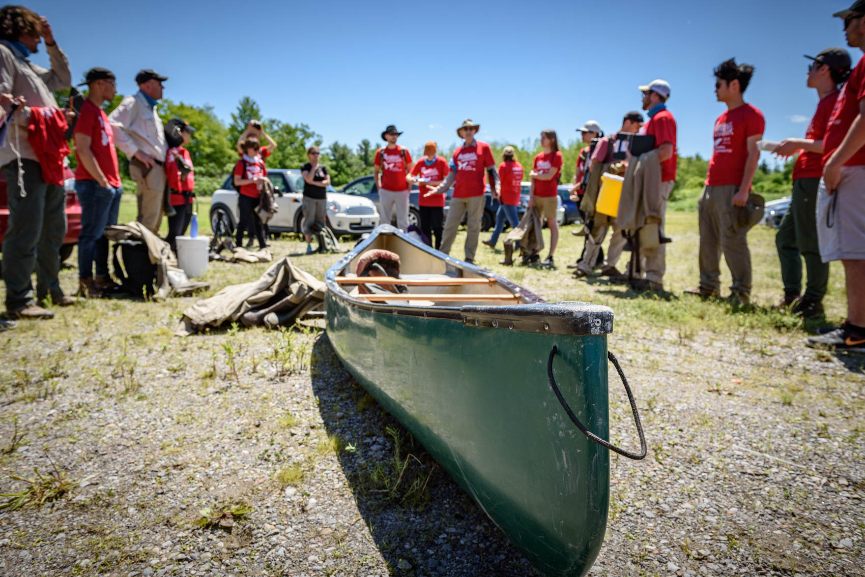 A group of BioBlitz participants surround a canoe at Rough Park