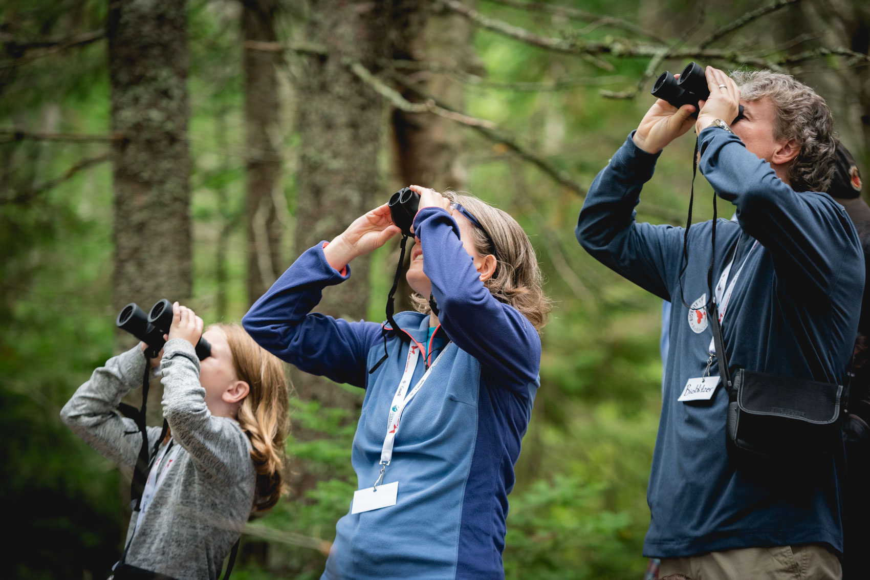 A child and her parents looking through binoculars in Blue Mountain-Birch Cove Lakes Wilderness Area