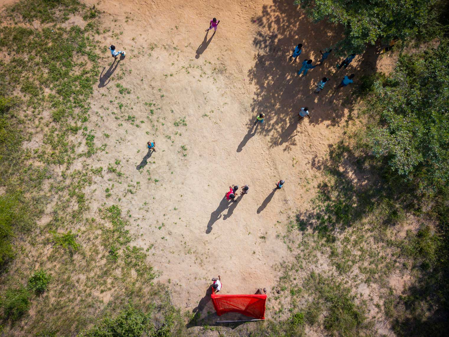 Arial view of children playing soccer at Nourish eco village in South Africa