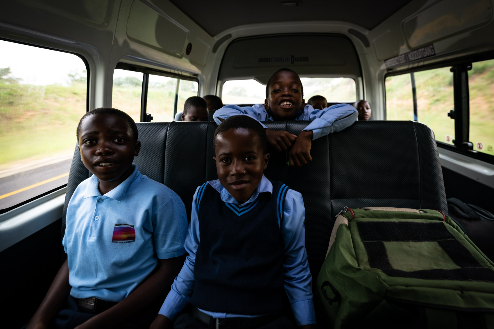 Three African school boys in a van in South Africa