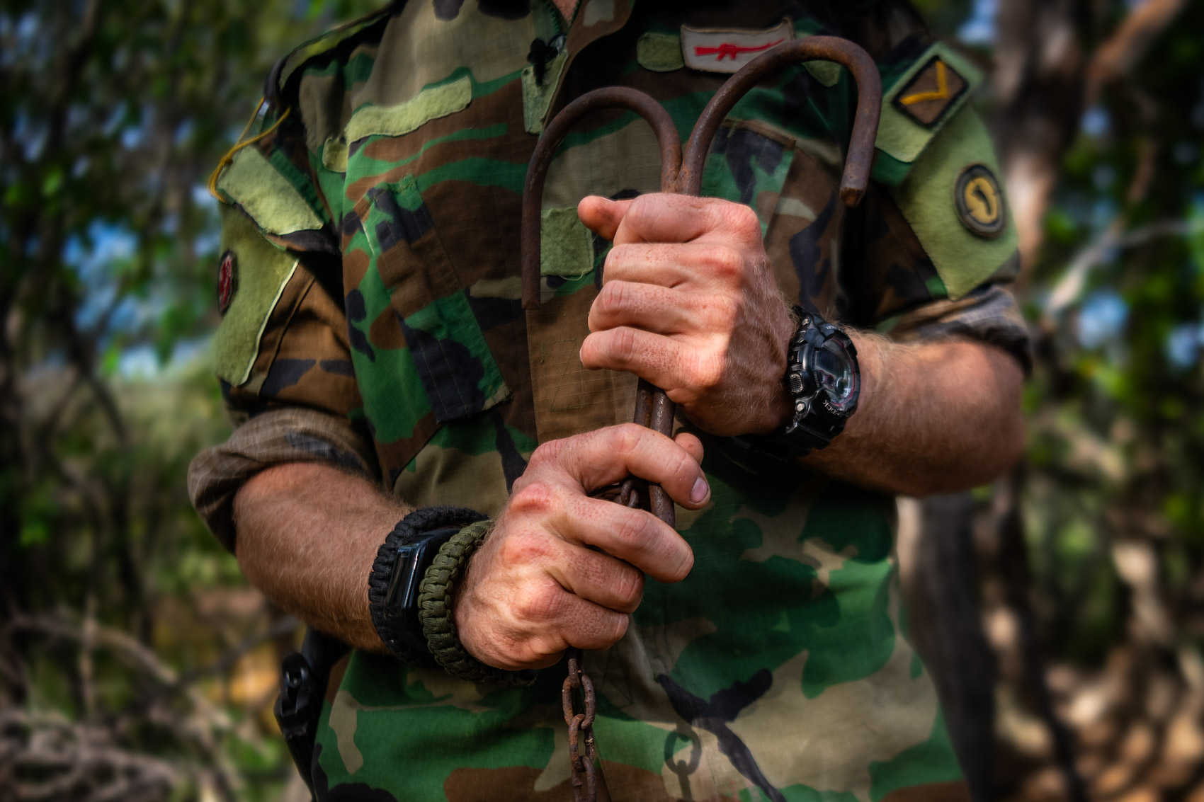 Protrack Anti-Poaching Unit ranger holding a rhino snare in hands © David Coulson conservation photojournalist